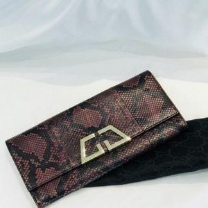232cf0f4400980 Women Gucci Python Handbag on Poshmark